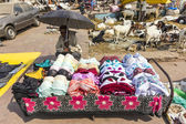 India man sells colorful bras at the market — Stock Photo