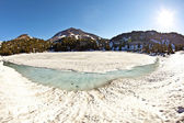 Crater lake with snow on Mount Lassen in the national park — Stock Photo