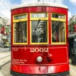 Stock Photo: Red trolley streetcar on rail in New Orleans French Quarter