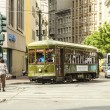 Red trolley streetcar on rail in New Orleans French Quarter — Foto Stock