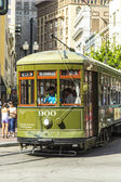 Green trolley streetcar on rail in New Orleans French Quarter — Stock Photo