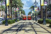 Red trolley streetcar on rail in New Orleans French Quarter — Stock Photo