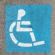 Wheelchair sign at the parking lot — Stock Photo