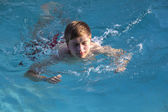 Boy enjoys swimming in the pool — Stock Photo
