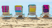 A row of three beach chairs overlooking the sea view — Stock Photo