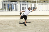 Man performs his Yoga exercises at the beach — Stock Photo