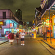 People on the move in the Burbon street at night in the French q — Stock Photo