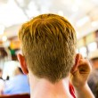 Teenage boy with earphones travels in the historic street car  — Stock Photo