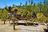 Old wagon and coaches at the entrance of the Furnance Creek Ranc — Stock Photo