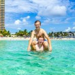 Stock Photo: Teen have fun playing piggyback in ocean