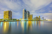 Skyline of Miami sunny isles by night with reflections at the oc — Stok fotoğraf