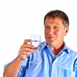 Thirsty man drinking out of a wine glass — Stock Photo #30611469