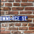 Stok fotoğraf: Old enamel streetsign Commerce Road