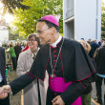 Постер, плакат: Bishop Franz Peter Tebartz van Elst greets the parents of the yo