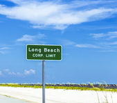 Street sign Long Beach at highway 90 in Pass Christian — Stock Photo