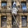 Iron fire escape is used for drying clothes — Stock Photo #31515215