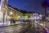 Streetcar rails in the old part of Lisbon by night — Stock Photo