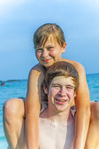 Boys have fun playing piggyback — Stock Photo