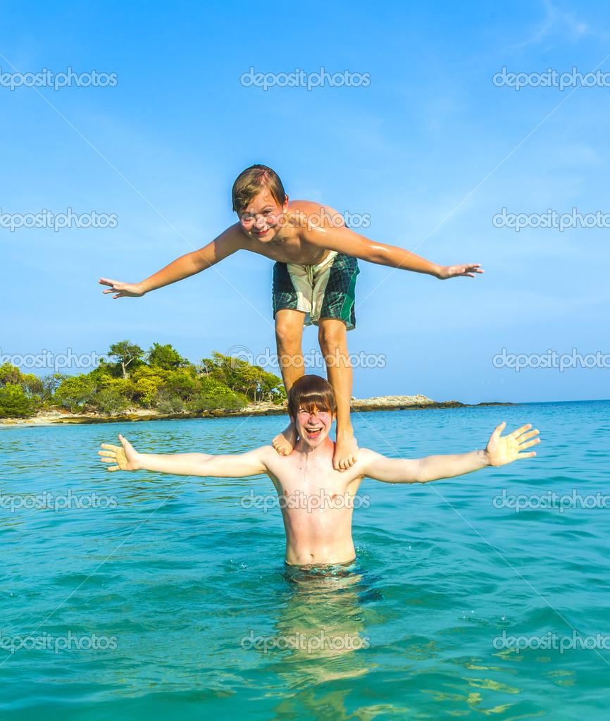 boys have fun playing piggyback stock photo hackman 32205385
