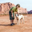 Dog loves to be hugged by tourist — Stock Photo