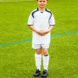 Young soccer player poses proudly  — ストック写真