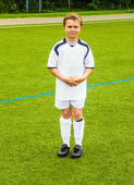 Young soccer player poses proudly — Stock Photo