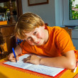 Boy prepares his homework for school — Foto Stock