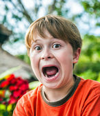 Young boy makes funny faces — Stock Photo