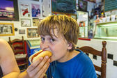 Boy in a diners — Stock Photo