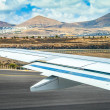 Stock Photo: Takeoff at airport of Lanzarote with volcanoes