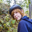 Stock Photo: Young teenage boy in forest with bike helmet