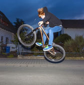 Boy with dirtbike is going airborne — Stock Photo