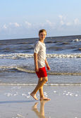 Teenager enjoys jogging along the beach — Foto de Stock