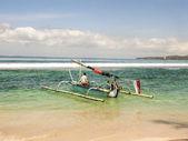 Fisherman goes fishing with his longboat — Stock Photo
