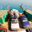Ferry with loading platform and cars — Stock Photo