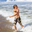 Boy in motion at the sea — Stock Photo