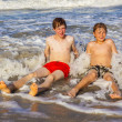 Boys have fun in the beautiful clear sea — Stock Photo