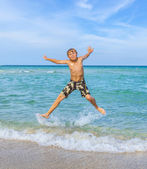 Boy enjoys the clear water in the ocean — Stock Photo