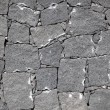 Typical wall made seamless from volcanic stone — Stock Photo #36797779