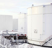 White tanks in tank farm with snow in winter — Stock Photo