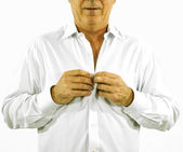 Man buttoning his white office shirt in the morning — Stock Photo