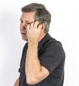 Man with hearing aid — 图库照片
