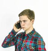 Teenage boy uses the mobile — Stock Photo