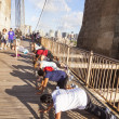 People enjoy exercises at Brooklyn Bridge in New York — Stock Photo #39481705