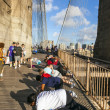 People enjoy exercises at Brooklyn Bridge in New York — Stock Photo #39481741