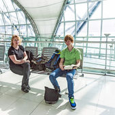 People wait for departure in the airport — Stock Photo