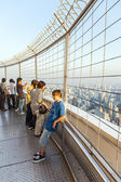 People enjoying the view from Bayoke tower across Bangkok skylin — Stock Photo