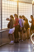 People enjoying the view from Bayoke tower across Bangkok skylin — Stock Photo