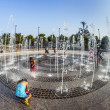 People in the public fountain area have a refreshing bath at the east harbor side — Stock Photo #39562313