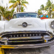������, ������: Classic Oldsmobile with chrome radiator grill parked in front o